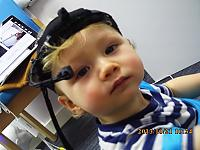 An infant wearing a head-mounted eye tracker at the Centre for Attention, Learning and Memory and the MRC Cognition and Brain Sciences Unit